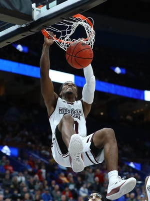 Mar 8, 2018; St. Louis, MO, USA; Mississippi State Bulldogs guard Nick Weatherspoon (0) scores on a slam dunk during the second half of the second round of the SEC Conference Tournament against the LSU Tigers at Scottrade Center. Mississippi State won 80-77. Mandatory Credit: Billy Hurst-USA TODAY Sports