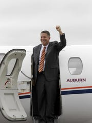 Auburn Tigers new head basketball coach Bruce Pearl greets fans after his arrival Tuesday at the Auburn University Regional Airport on  Mar 18, 2014.