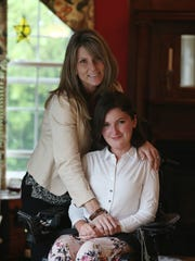 Anna Landre with her mother Laura Landre in the Howell home.