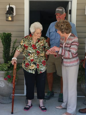 Mayor Kim McMillan presents Mildred Johnson with a set of keys to her new home on June 29. Johnson's home was originally a rehab project under the City's Housing Rehabilitation Program, but turned into a complete rebuild after extensive repairs were identified.