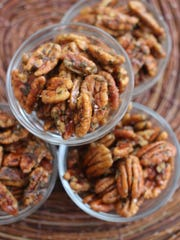 Maple Rosemary Pecans make a nice appetizer or topping for salads.