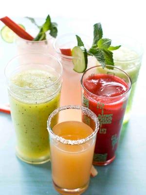 From left clockwise, green granny slush, cucumber rhubarb mojito, raspberry daiquiri and ruby rita drinks.