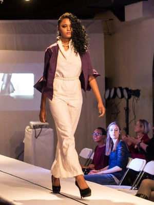 """The designs of student Tiye Gardner were featured as an opening act during the Ann De Evelyn Clothing Company """"Fall Fashion Experience."""" Miss Gardner is part of the student design program at Manual High School. 10/9/14"""