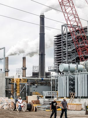 A new cleaner burning natural gas plant is being built near old coal-fired boilers at the LG&E Cane Run Generating Station in Louisville. LG&E officials said they needed to make the change to meet federal clean air rules.