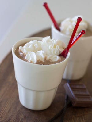 This Nov. 3, 2014 photo shows vanilla bean cheesecake hot cocoa in Concord, N.H. Once the cooler weather arrives, the hot coca craving can intensify. (AP Photo/Matthew Mead)