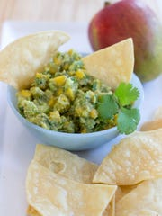 There are multiple ways to serve up guacamole for the Super Bowl including mango and balsamic vinegar.