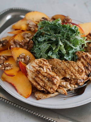 Grilled chicken paillard with peach and arugula salad represents food choices that can help you stick to a New Year's resolution.