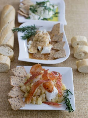 This Jan. 12, 2015 photo shows, from foreground, prosciutto pear ricotta dip, sesame garlic honey ricotta dip, and herb ricotta dip in Concord, New Hampshire.