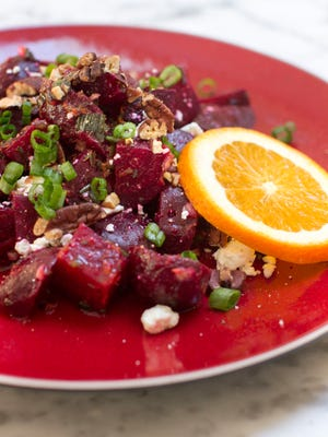 Roasted beets are paired with orange vinaigrette, pecans and goat cheese.