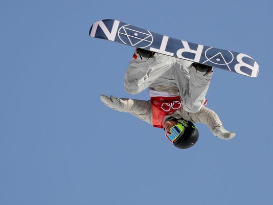 Redmond Gerard, of the United States, jumps during the men's Big Air snowboard qualification competition at the 2018 Winter Olympics in Pyeongchang, South Korea, Wednesday, Feb. 21, 2018. (AP Photo/Kirsty Wigglesworth)
