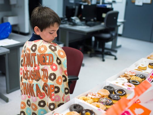 Tyler Carach, 9, known as 'Donut Boy,' shows off his