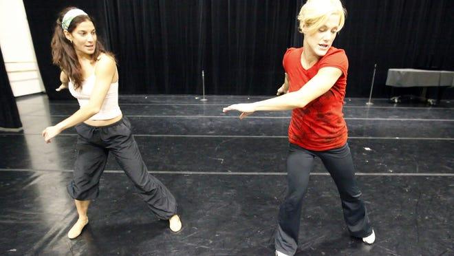 Choreographer Heather Britt, right, takes Cincinnati Ballet dancer Gema Diaz through some steps in this Enquirer file photo.