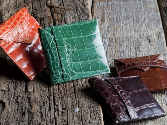 Ann J. Lee designs alligator card cases for men and women.