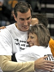 Patty Street hugs former Iowa basketball player Wade Lookingbill in 2013 after a halftime ceremony in honor of Street's son, Chris, who died on Jan. 19, 1993.