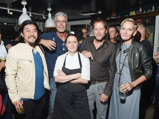 "From (left to right) chef Ed Lee, Anthony Bourdain and chefs April Bloomfield, David Kinch, and Gabrielle Hamilton attend ""The Mind of a Chef"" season 4 premiere party, powered by Breville, at The Spotted Pig in 2015 in New York City."