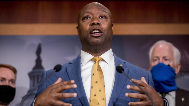 Sen. Tim Scott, R-S.C., accompanied by Republican senators, speaks at a news conference to announce a Republican police reform bill June 17 on Capitol Hill in Washington.
