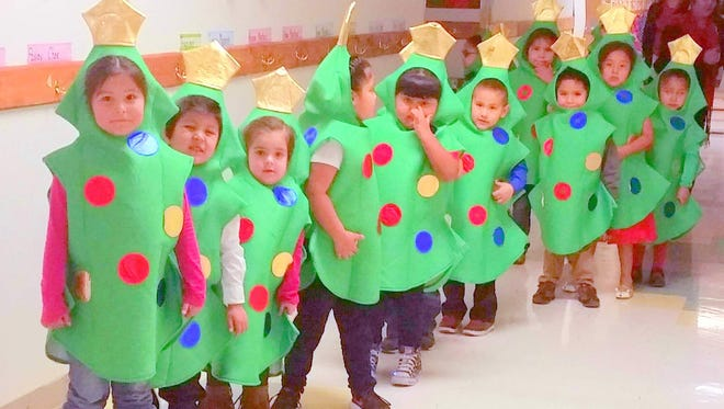 A dozen pre-kindergarten Mescalero students wait to perform in a holiday show.