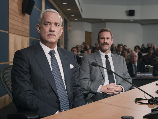 Tom Hanks (left) and Aaron Eckhart face scrutiny in