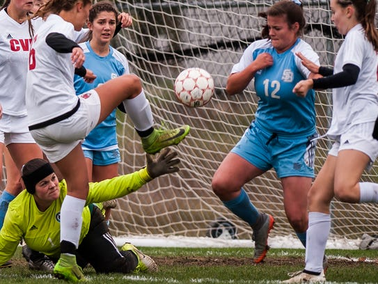 CVU #16 Natalie Durieux tries to take another shot