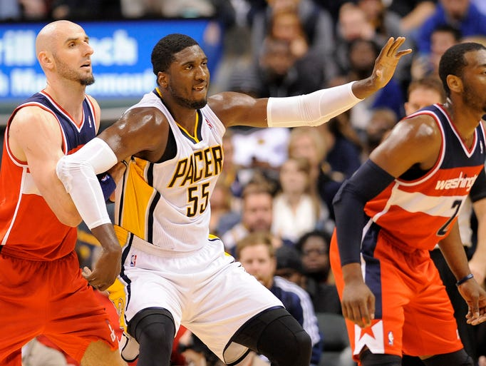 Indiana's Roy Hibbert calls for the ball while posting up Washington's  Marcin Gortat, Friday, November 29, 2013, inside Bankers Life Fieldhouse.