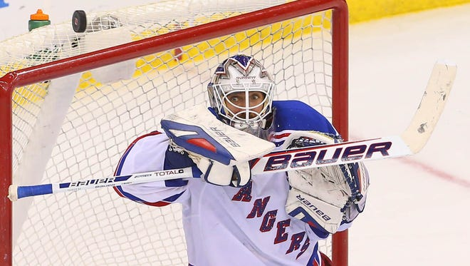 Rangers goalie Henrik Lundqvist eyes the puck during his club-record-setting 2-0 shutout of the Devils in Newark, N.J., on Saturday night.