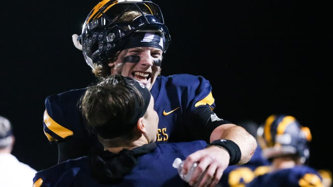 Brock Vandagriff (12) celebrates with Prince Avenue's Logan Johnson (1) during a GHSA high school football game between Prince Avenue Christian and Athens Academy in Bogart, Ga., on Friday, Oct. 23, 2020.