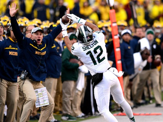 Michigan State receiver R.J. Shelton catches a Connor Cook pass on the sidelines during the third quarter of the Spartans' 27-23 victory over Michigan Saturday. The play was originally rule incomplete because he foot was close to being out of bounds, but that ruling was overturned after a review. The 27-yard, toe-dragging grab along the sideline set up an MSU touchdown to cut a 10-point deficit to 17-14.