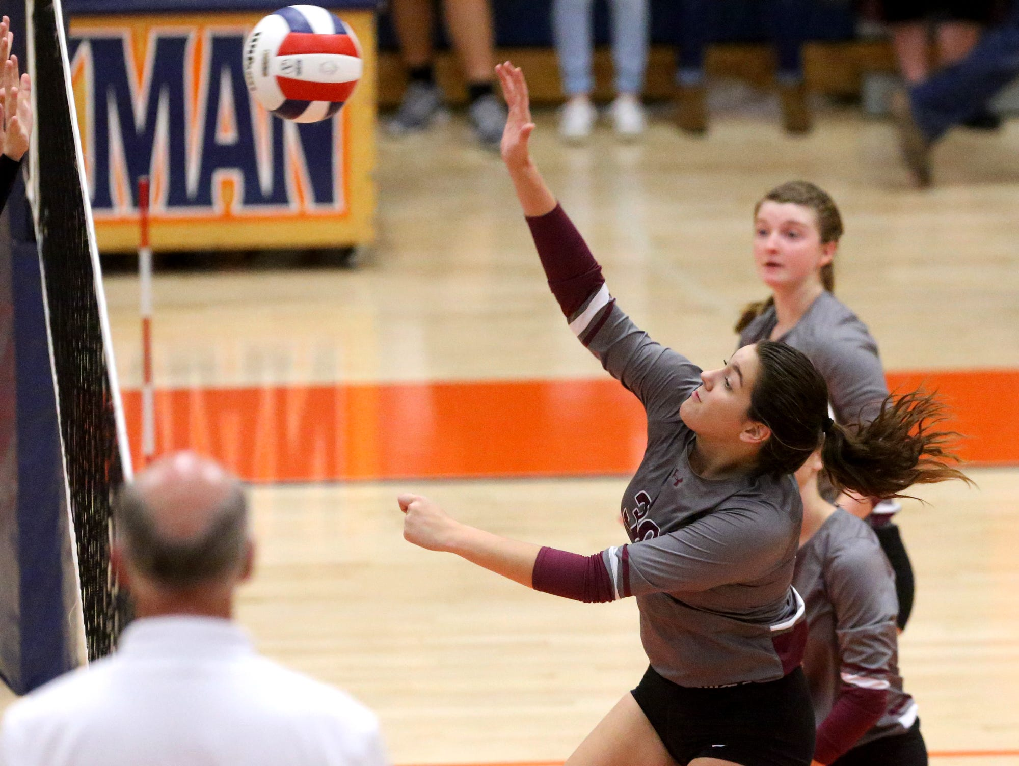 Eagleville's Tori Laidig (30) hits the ball over the net during the first round of the TSSAA Class A state volleyball tournament against Jackson County, on Wednesday, Oct. 21, 2015, at Blackman.