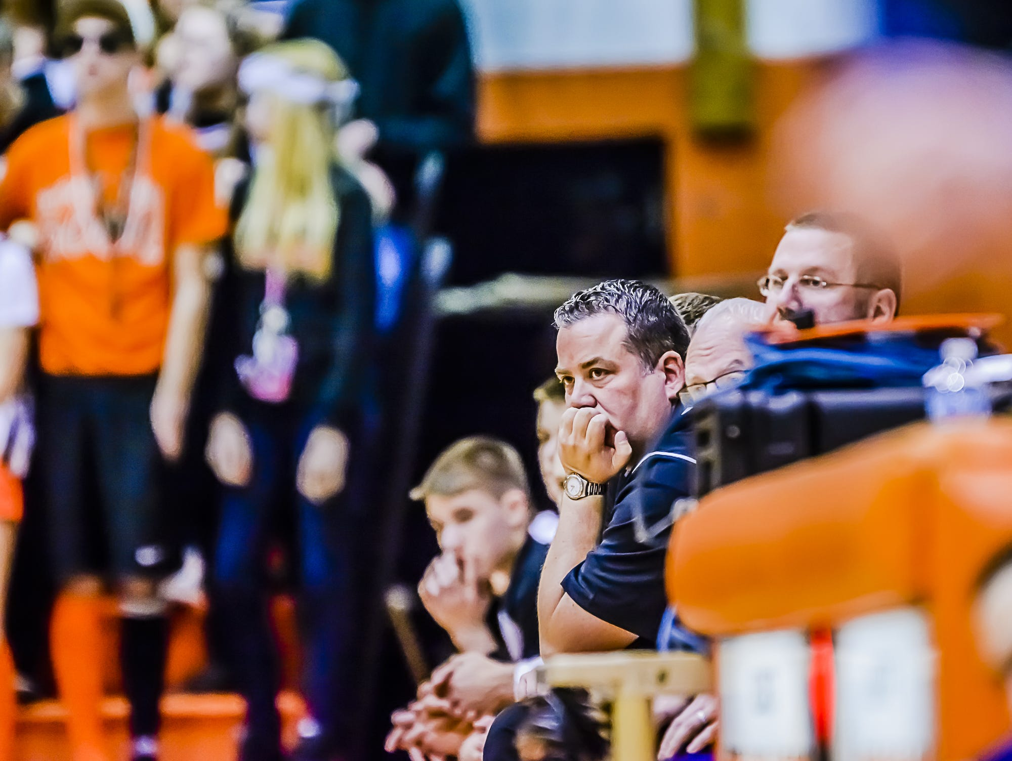 Former Charlotte Boys Basketball Head Coach Steve Ernst watches Godwin Heights pad their lead over his team during a regional final game last March in Charlotte. Ernst resigned on Monday.