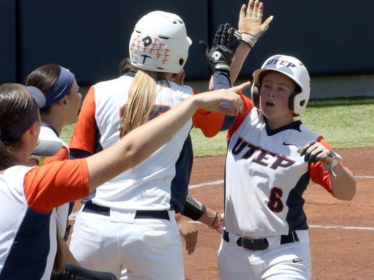 UTEP's Kaitilin Ryder, 6, is greeted by teammates after scoring a run early in their game against UAB Saturday at Helen of Troy Field.