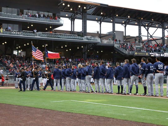 The San Diego Padres watch as a color guard retires