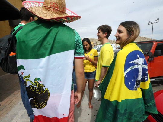 Brazil fans, including Carina Secco Walker, right,