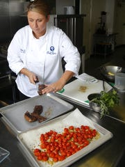 Lauren Van Liew, owner of Chef Covas Catering in Red Bank, prepares a meal.