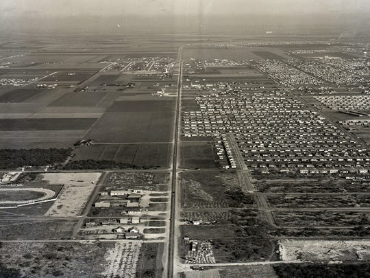 An aerial view of Lexington Boulevard and the Weber Road intersection on Aug. 10, 1954, looking northwest toward Chapman Ranch Road. The circular track in the lower left corner is Lexington Park Speedway.