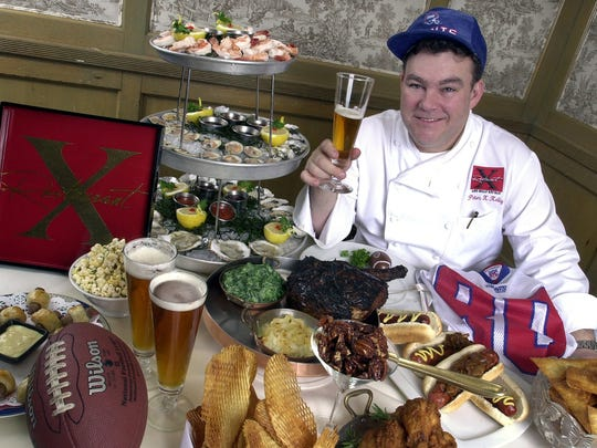 Chef Peter Kelly displays and the spread he intended for a Restaurant X Super Bowl party in 2004. Note: It included Niman Ranch hot dogs, and grilled Cote du Beouf.