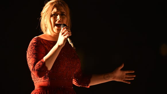 Adele performs during the 58th Grammy Awards.