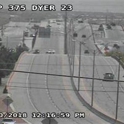 A highway camera shows police blocking Loop 375 after