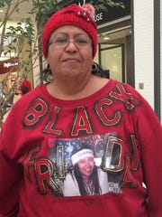 "Jeanette Santiago, of Hopewell Junction, goes out on Black Friday to honor her daughter, Gloria, who loved to organize the family's Black Friday shopping. Gloria died from lupus in 2007, and the family shops ""in her memory."""