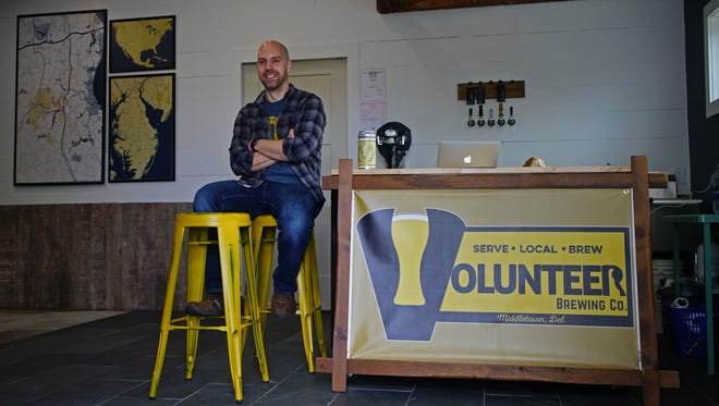 Kevin Schatz, owner of Volunteer Brewing Company in Middletown, sits in the two-car garage-turned-brewery on an alley way off West Main Street.