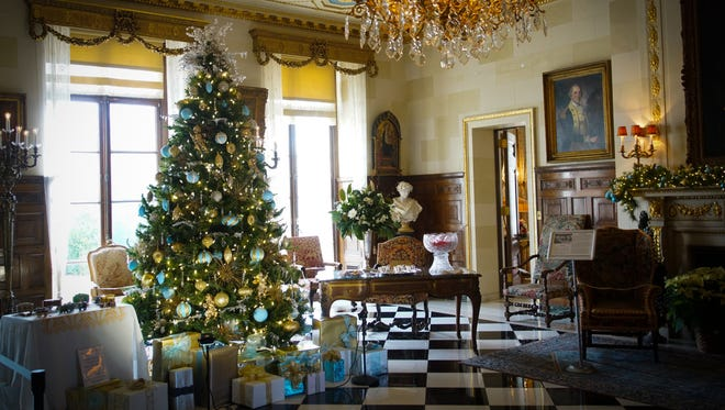 The foyer of the Nemours Mansion and Gardens, a 300-acre country estate of the late industrialist and philanthropist Alfred I. duPont, decorated for Christmas.