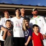 Katie Mayberry poses for a portrait at her Springfield. home with her husband, Sean Mayberry; mother Joanie Armstrong, stepfather Lee Tiehen and her children Aiden, Kylie and Rylan on Oct. 28.