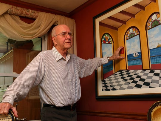 Jose Alvarez, 77, who left his native Cuba at age 23, talks about a painting he did that was inspired by memories of Cuba.
