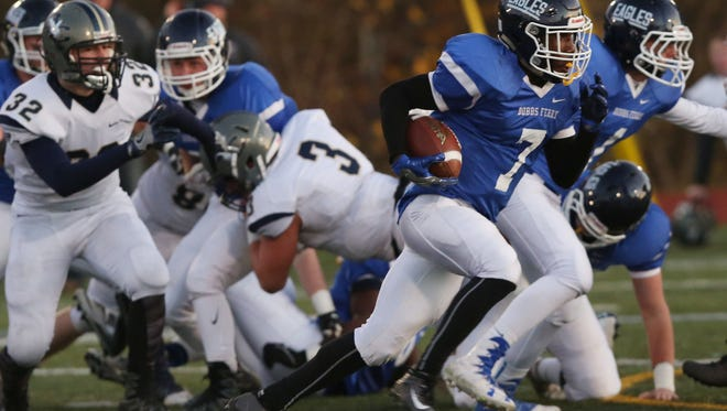Dobbs Ferry's Najee Smith (7) looks for some running room in the Burke Catholic defense during the Class C regional semifinal football game at Mahopac High School Nov. 12, 2016.