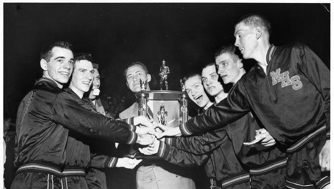 Bobby Plump (second from right) of Milan High School and his Indian teammates celebrate after winning the state high school championships on March 20, 1954.