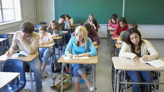 Students writing in a classroom
