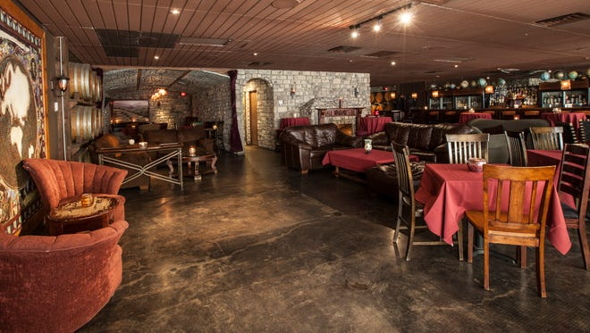 The lounge at Kazimierz World Wine Bar featured stained-glass walls, wine casks and cushy couches.