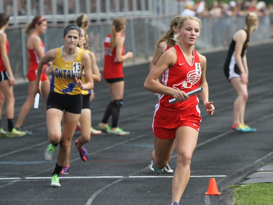 Bellevue's Lauren Turner competes in the final segment of the 4 x 800 meter relay during the Division II Track and Filed Regional Championships at Lexington High School on Thursday afternoon.