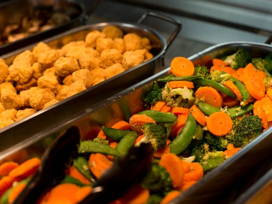 Popcorn chicken (left) and sauteed vegetables are part