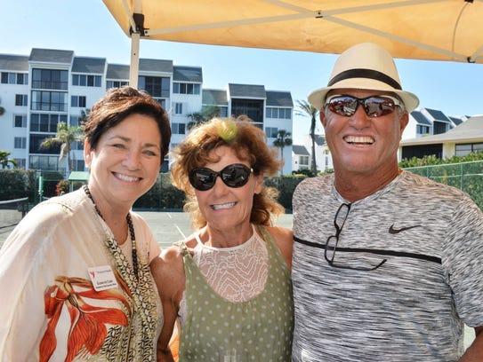 Julie Wheeler, center, with Treasure Health President