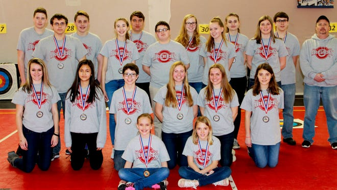 Nineteen Manitowoc Public School District/Manitowoc Park and Recreation Archery Club members participated in the National Archery in the Schools Program State Tournament in the Wisconsin Dells March 31. Pictured (from left): sitting: Kira DeWitt and Rhyce Thomas; kneeling: Kirsten Boettcher, Esther Thielbar, Alex Lemberger, Courtney Braun, Halle Braun and Riley Thomas; first row, standing: Ryan Kubec, Katherine Ackley, Bryce Walsh, Emily Burns and Adrianna Sprang; and back row: Jacob Tienor, Ben Walsh, JT Shields, Mel Spaeth, Izzy Balma, Dawson Boettcher and Coach Koch.